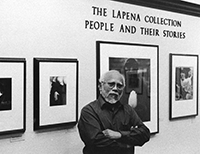 Photo of Frank LaPena standing in front of art gallery wall.